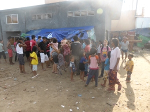 Eager crowds gather for food and shelter